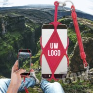 travel and Hiking to Iceland's highest waterfall - Glymur. hiker makes selfi by photographing his legs from above. A man is sitting on the edge of a cliff